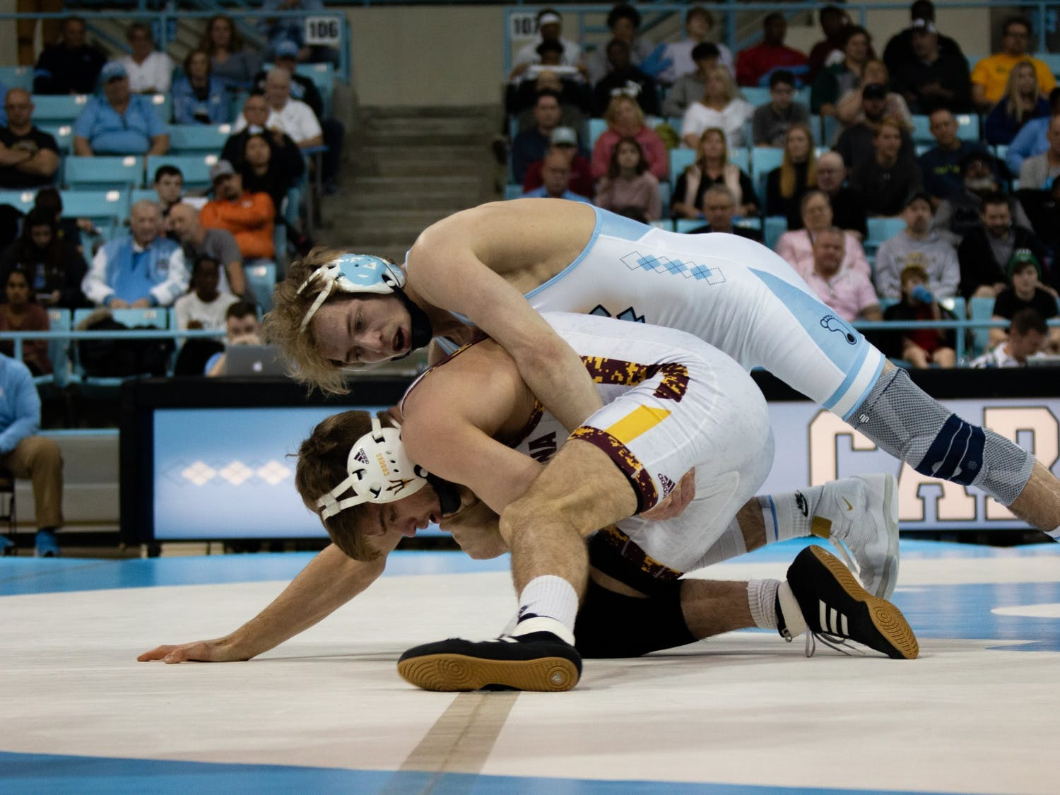 UNC's Zach Sherman, a redshirt sophomore at the time, wrestles against Arizona State redshirt junior Cory Crooks in Carmichael Arena on Sunday, Feb. 23, 2020.