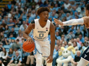 UNC first-year guard Anthony Harris (0) dribbles down court in the Smith Center on Monday, Dec. 30, 2019. Harris left the game early after sustaining a knee injury during the game against Yale. UNC defeated Yale 70-67.