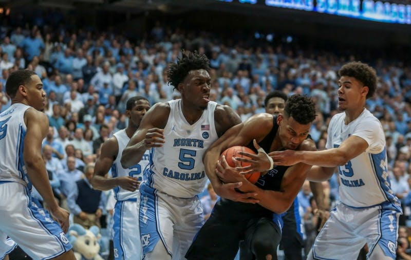 UNC first-year forward Nassir Little (5) and Duke junior forward Javin DeLaurier  (12) compete for the ball during the home game against Duke on Saturday, March 9 2019 at the Smith Center. The Tar Heels defeated the Blue Devils 70-79 on their senior night, finishing as ACC regular season champions.
