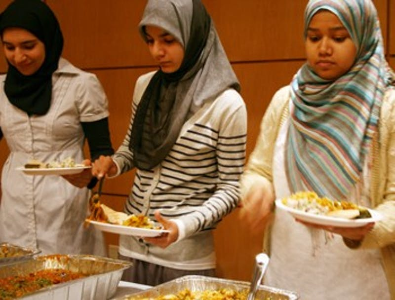 From right, Bushra Farooqui, a senior, and Umber Siddiqui, a freshman, are members of Sangam and the Muslim Student Association