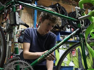 Christina Graves repairs a bike on Bike Wrenching Night at ReCYCLEry on Tuesday, Oct. 30. Bike Wrenching Night is an open shop held most Tuesdays aimed at women/trans/femme/non-binary individuals for bicycle repair and to improve mechanic skills.