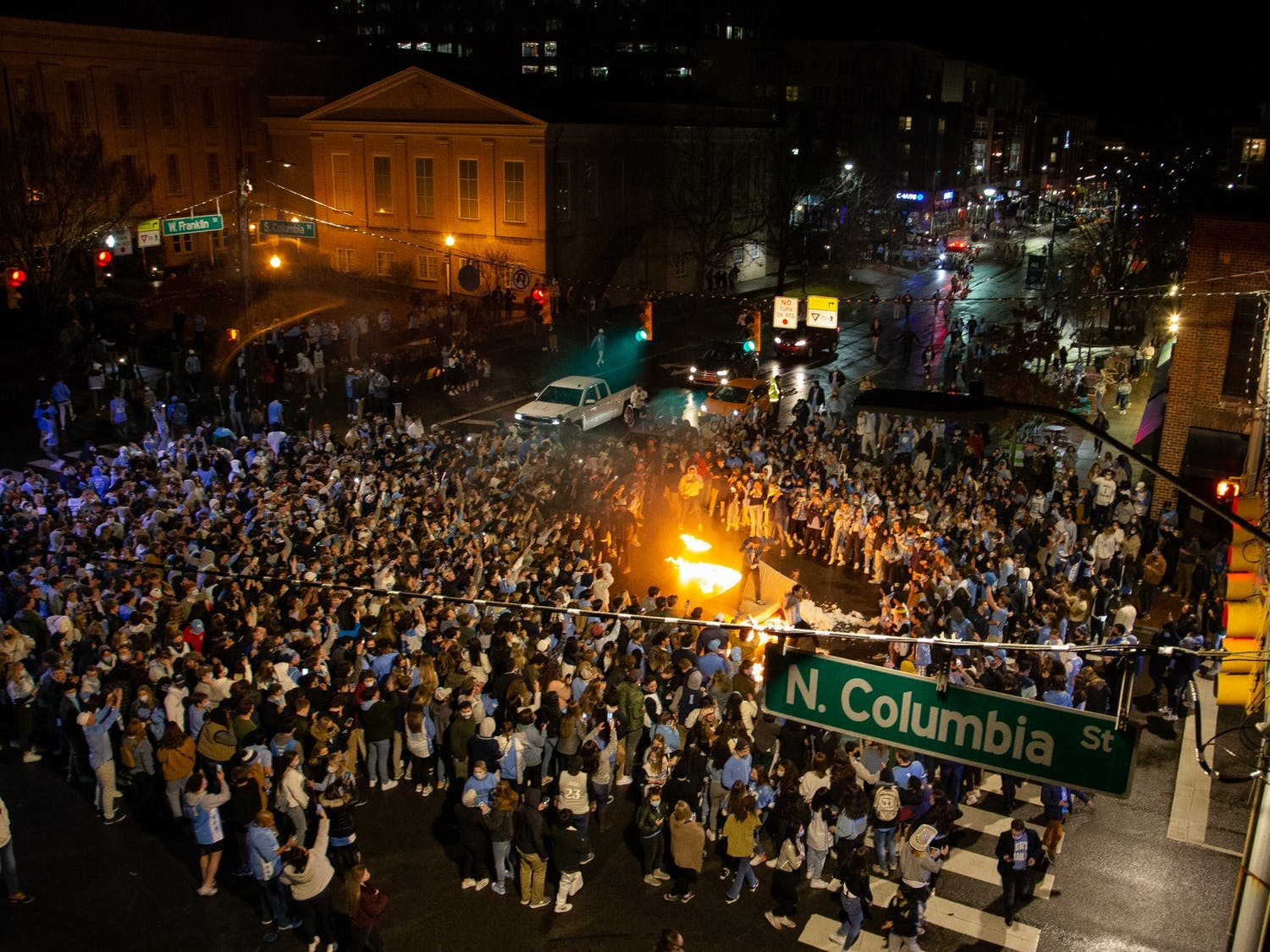 UNC fans rush Franklin Street  and light a mattress on fire after UNC's basketball team triumphs over Duke despite COVID-19 restrictions on Saturday, Feb. 6, 2021.