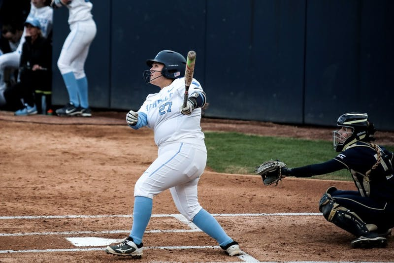 UNC senior third baseman Berlynne Delamora (27) looks in to the sky after hitting the ball during the 4-1 win over Georgia Tech on Friday, March 22, 2019 in Anderson Stadium in Chapel Hill, N.C. The Tar Heels improved their record to 6-1 in ACC play.