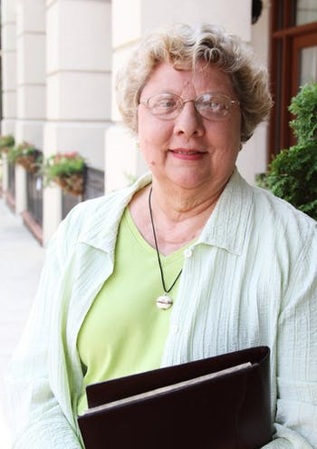 Pat Evans, current chairwoman of Friends of Downtown Chapel Hill, stands outside the Franklin Hotel.
