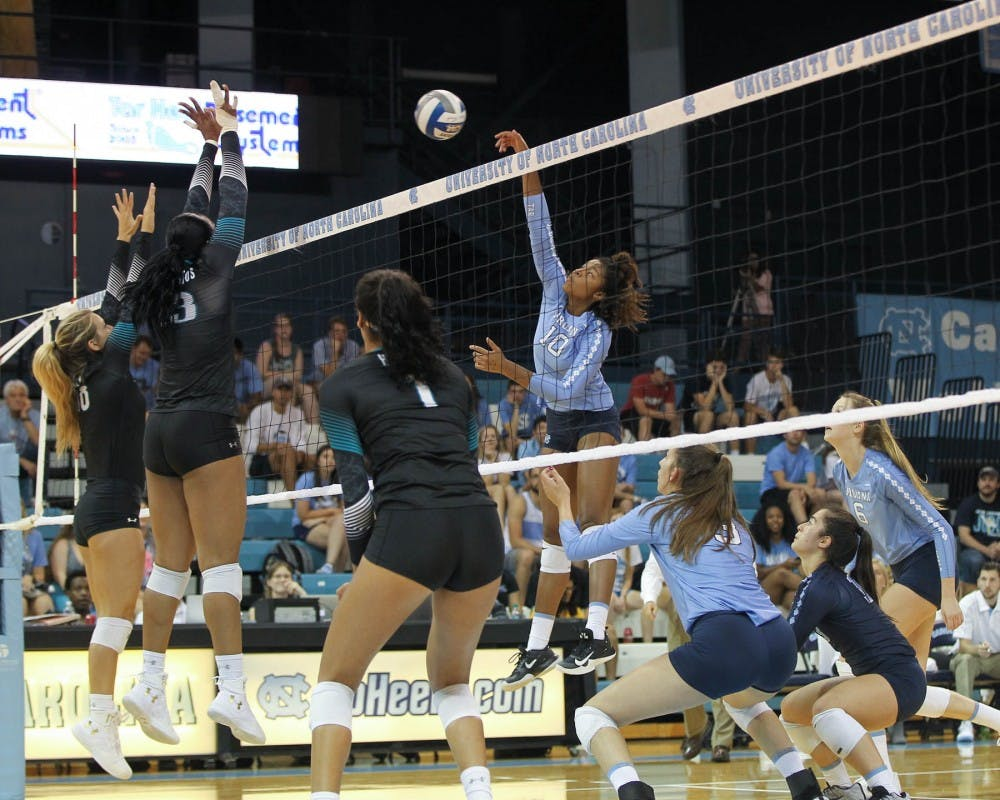 <p>Middle hitter Sydnye Fields (10) spikes the ball during Saturday's game against Coastal Carolina in Carmichael Arena.</p>
