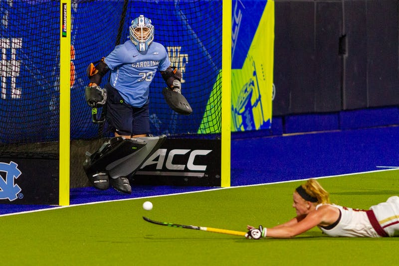 UNC senior goalkeeper Amanda Hendry (30) stands in the goal as Boston College sophomore forward Margo Carlin (24) attempts to save the ball in Karen Shelton Stadium Nov. 5, 2020. The Tar Heels beat the Eagles 4-0 in the first round of the ACC playoffs, securing head coach Karen Shelton's 700th win.