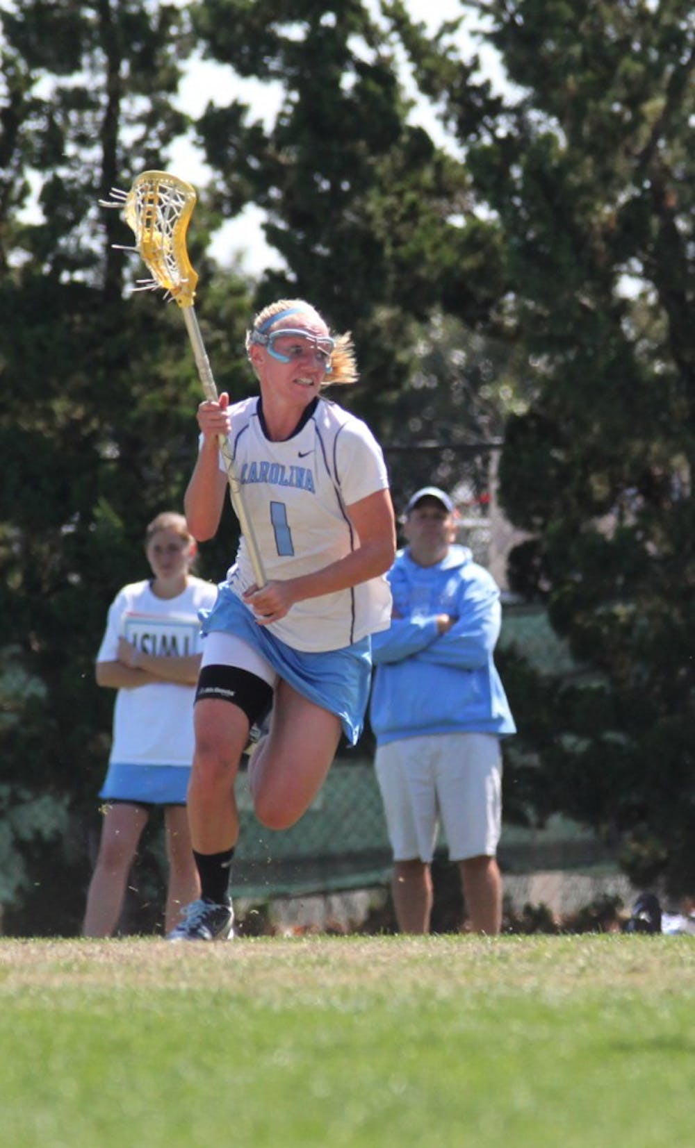 <p>Junior midfielder Laura Zimmerman attacks the Georgetown defense on Saturday. She rang up four goals on seven shots while chipping in an assist for the Tar Heels in the win.</p>