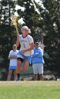 Junior midfielder Laura Zimmerman attacks the Georgetown defense on Saturday. She rang up four goals on seven shots while chipping in an assist for the Tar Heels in the win.