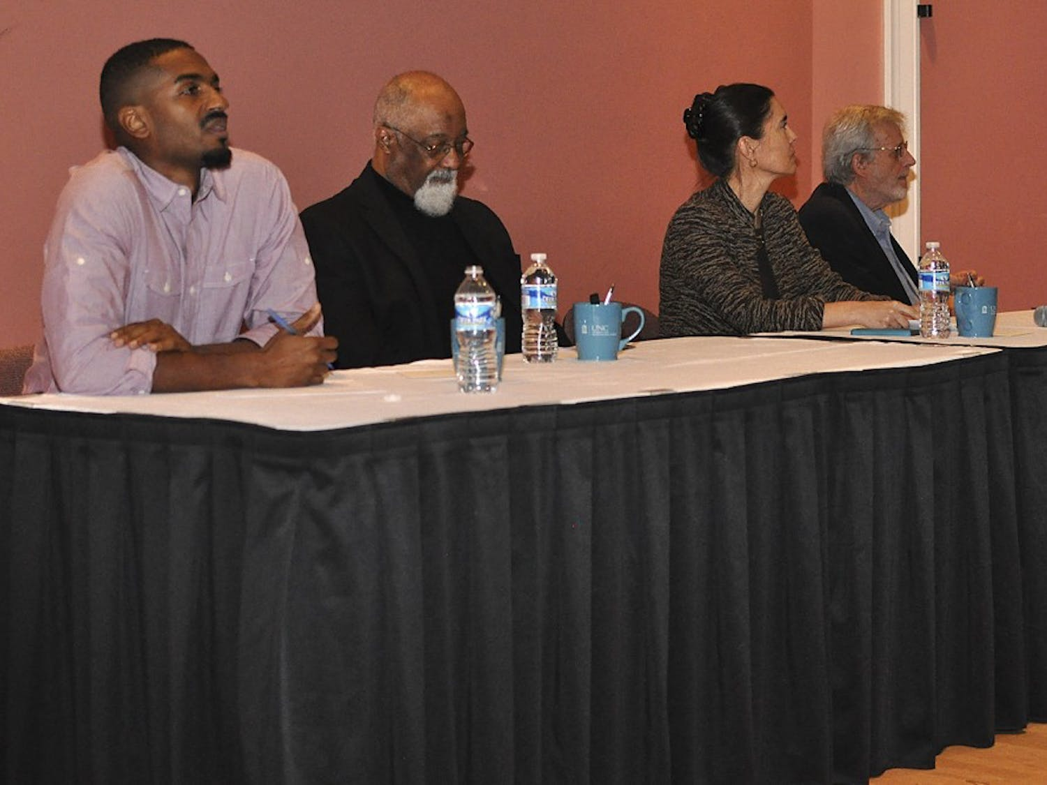 From left, Ori Burton, Irving Joyner, Anita Earls and Al McSurely participated in Thursday night's 50 Years After the Dream: Race and the Justice System Panel.