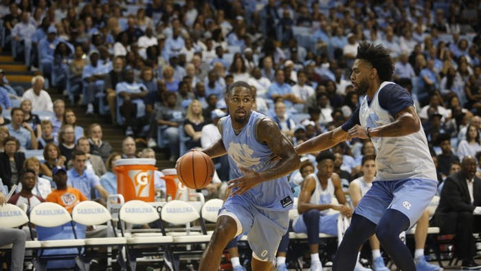 Guard Seventh Woods (0) dribbles around teammate Joel Berry II (2) in UNC's Late Night With Roy on Oct. 13.