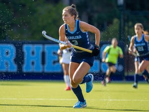 Senior forward Hannah Griggs (3) runs with the ball at the field hockey game against Louisville on Oct. 22 at the Karen Shelton Stadium.