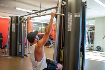 A student at Lark Chapel Hill Apartments works out in the building's recently re-opened gym on Thursday, Oct. 1, 2020.