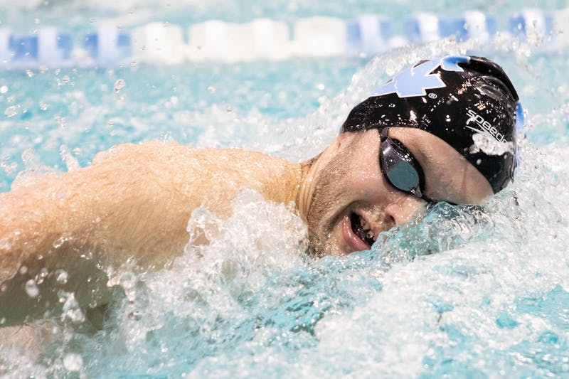 UNC senior Andrew Heise competes in the men's 100-meter freestyle during a meet against N.C. State in Koury Natatorium on Friday, Jan. 17, 2020. The Tar Heels' fell to the Wolfpack 187.5- 112.5 in men's and 182-118 women's.