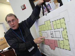 During a Sunday open house, Charles House, board member on the Inter-Faith Council, explains how living arrangements will be set up at a planned new community center.