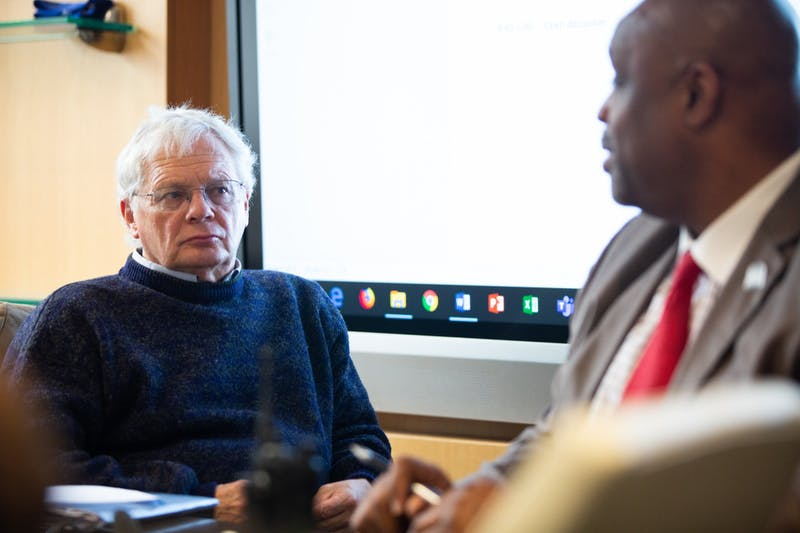 Chair of the Faculty Lloyd Kramer (left) listens as UNC Police Chief David Perry (right) speaks during a Faculty Executive Committee Meeting in South Building on Monday, Nov. 4, 2019. Perry emphasizes the need for the police force to build a rapport with their community.