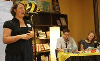 Amanda Smith spells a difficult word at the Adult Spelling Bee at Flyleaf Books.