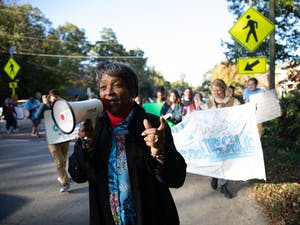 Protestors gathered in downtown Chapel Hill Friday to push the candidates of local elections to support more effective affordable housing policies.