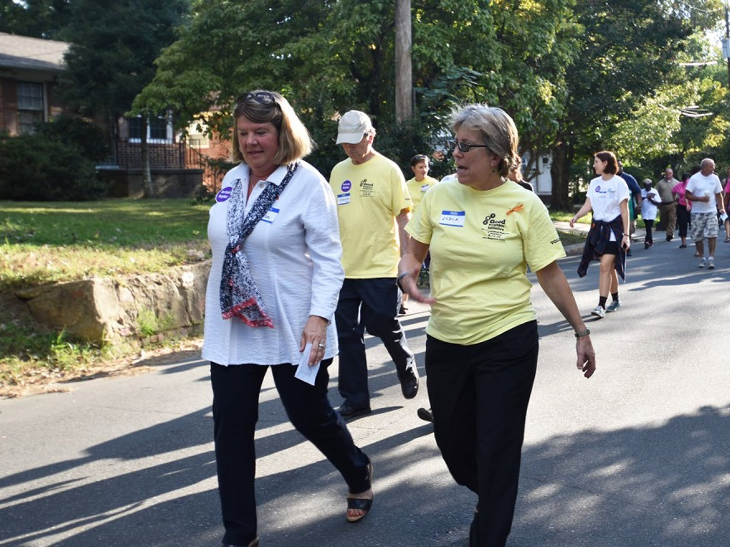 Mayor of Chapel Hill, Pam Hemminger and Mayor of Carrboro, Lydia Lavelle lead a walk around the neighborhood at the good neighbor block party at Hargraves Community Center on Tuesday evening.