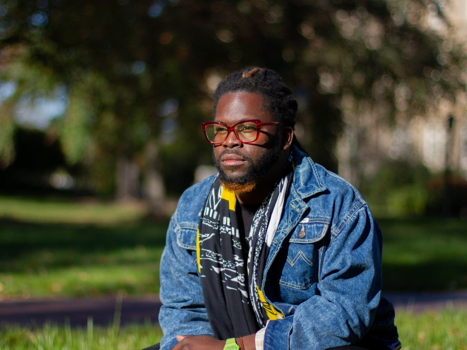 """CJ Suitt, Chapel Hill's first-ever Poet Laureate, poses for a portrait in Chapel Hill on Wednesday, Nov. 4, 2020. """"There's a lot of hope and uncertainty right now,"""" Suitt said."""