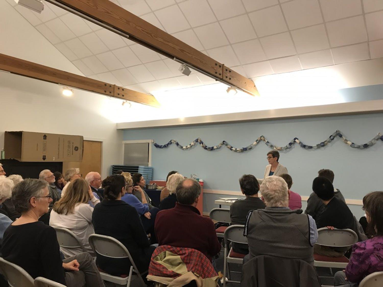 Reverend Julie Peeples addresses the community at Chapel Hill Friends Meeting.