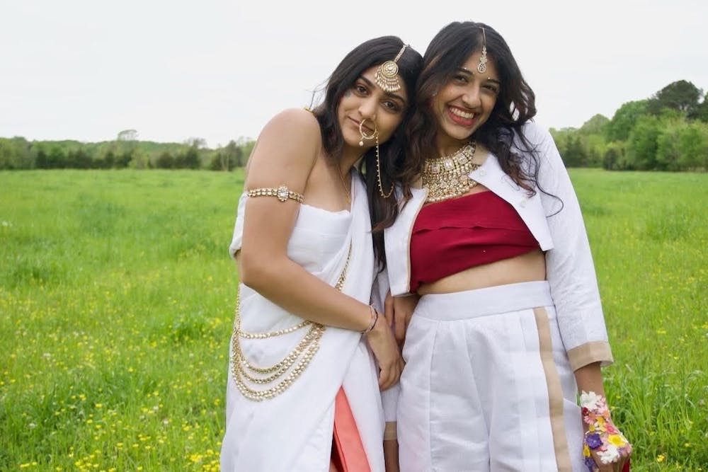 <p>Pareen Bhagat(left), Hrishika Muthukrishnan(right) are dressed in clothing designed by Pareen Bhagat and accessorized in traditional Indian jewelry and colors. Photo courtesy of Izzy d'Alo.&nbsp;</p>