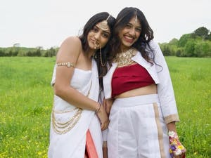 Pareen Bhagat(left), Hrishika Muthukrishnan(right) are dressed in clothing designed by Pareen Bhagat and accessorized in traditional Indian jewelry and colors. Photo courtesy of Izzy d'Alo.