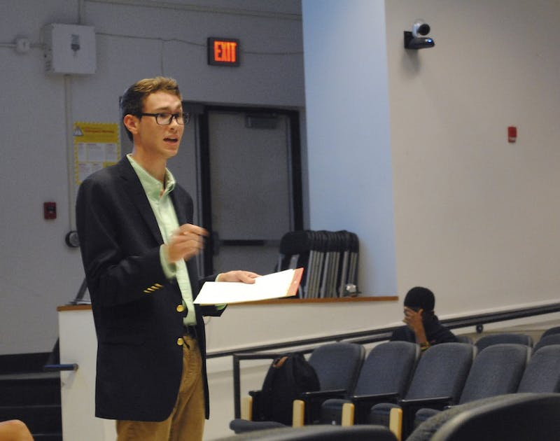 Graham Lowder, member of the Young Democrats, participates in a debate against the College Republicans on Wednesday. The teams discussed issues including climate change, immigration, and higher education.