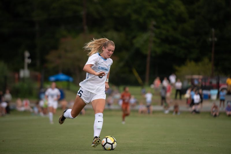 Redshirt sophomore forward Taylor Otto (6) dribbles the ball during a 1-1 tie against No. 21 Texas on Aug. 22 at Finley Field South.