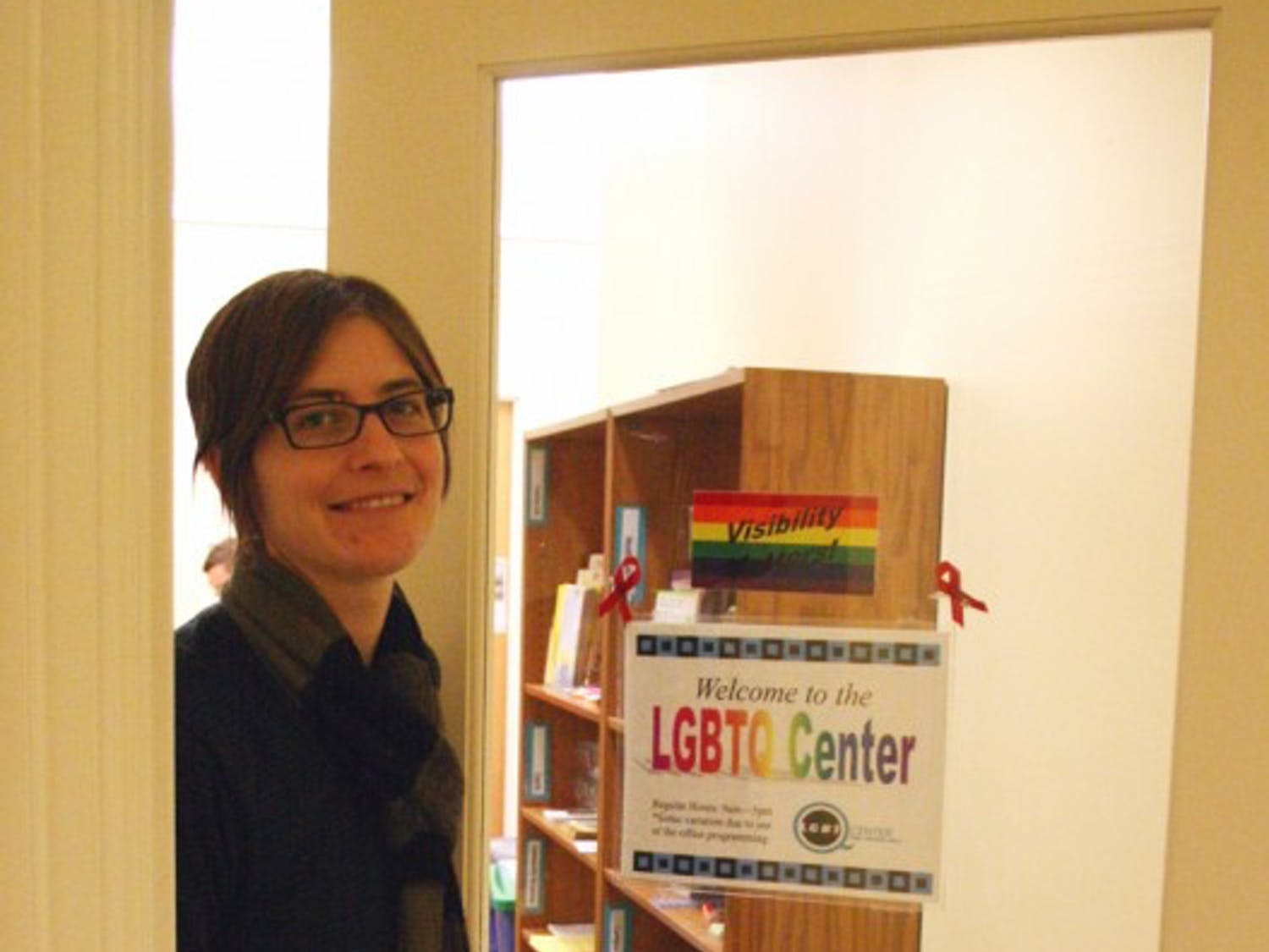 Danny DePuy, assistant director of the Lesbian, Gay, Bisexual, Transgender and Queer Center, stands at its door.  She thinks there needs to be more education about cyber bullying effects.