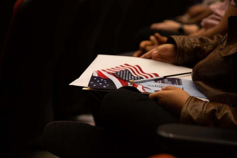 New citizens are sworn in on April 12, 2019 at the FedEx Global Education Center during a naturalization ceremony.