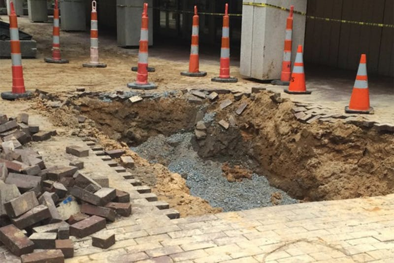 The large hole in front of Greenlaw was caused by a water main break.