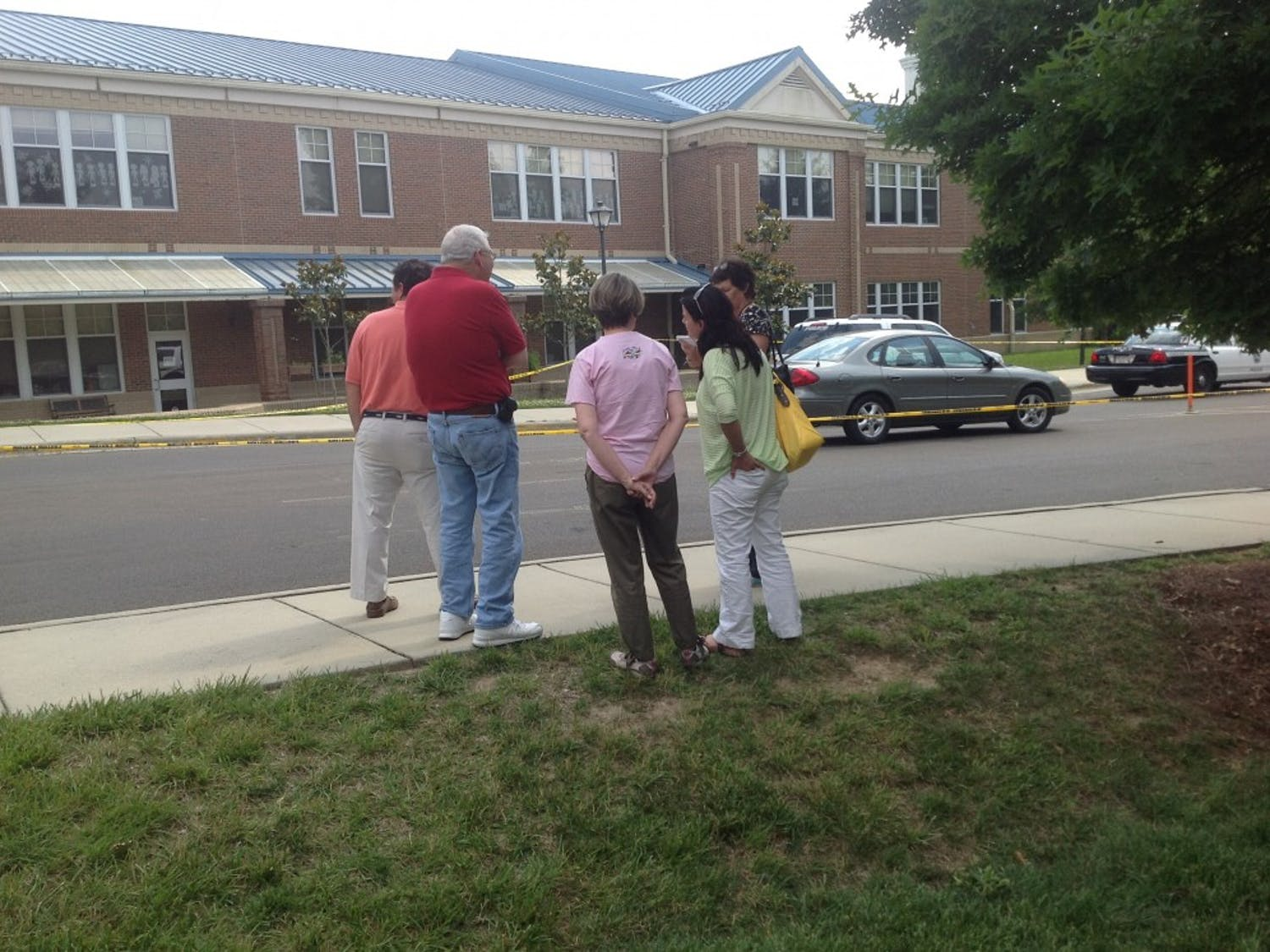 Onlookers watch the scene at Mary Scroggs Elementary after a shooting on May 25.