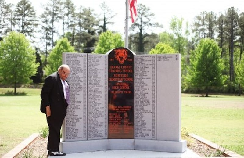 The Orange County School Board unveiled a new monument at the former Lincoln High School building. The monument celebrated the people who graduated from Lincoln High School before the all-black high school was desegregated. Photo by Isabella Bartolucci.