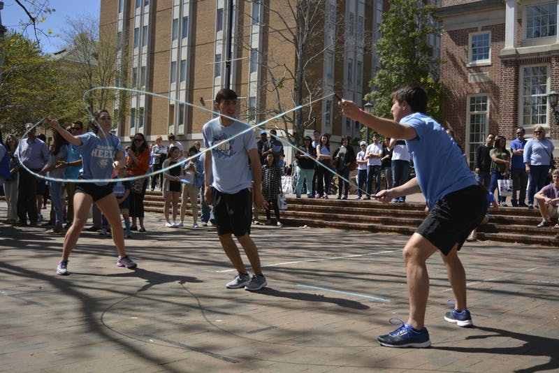 Graham Booth (Left, First-year), Sarah Chen (Med Student), and Noah Mancuso (So.) performed as part of Carolina Jump Rope Club's show in the Pit for students and families on Sunday April 9, 2017.
