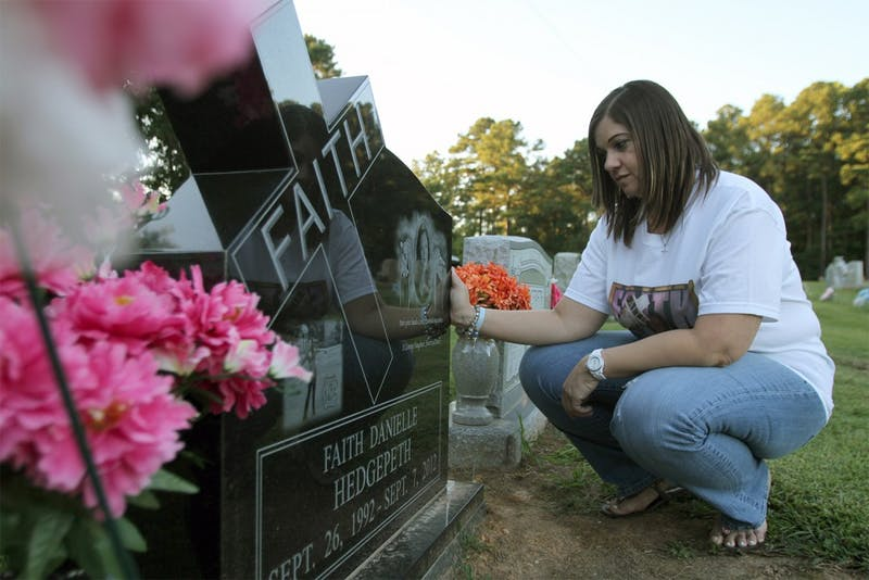 Rolanda Hedgepeth visits her sister Faith's grave one year after Faith's homicide. Another year has passed with no charges filed.