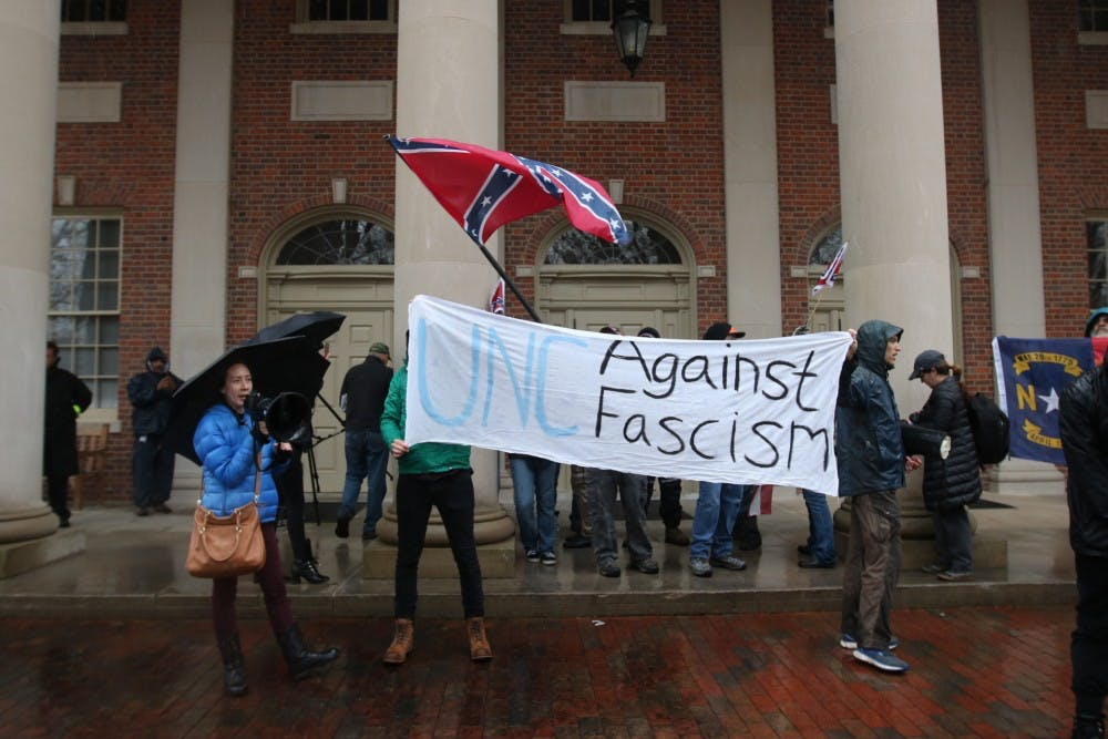 Pro-Confederate and anti-Silent Sam activists clash following tensions over plaques