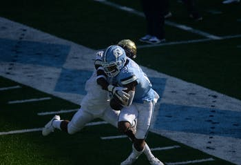 UNC junior wide receiver Dyami Brown (2) attempts to make a catch during a game against Wake Forest on Saturday, Nov. 14, 2020 in Kenan Memorial Stadium. UNC beat Wake Forest 59-53.