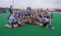 The North Carolina field hockey team poses with the National Championship trophy following a 2-0 win over Maryland at Trager Stadium in Louisville, Ky. Photo courtesy of Jeffrey A. Camarati.