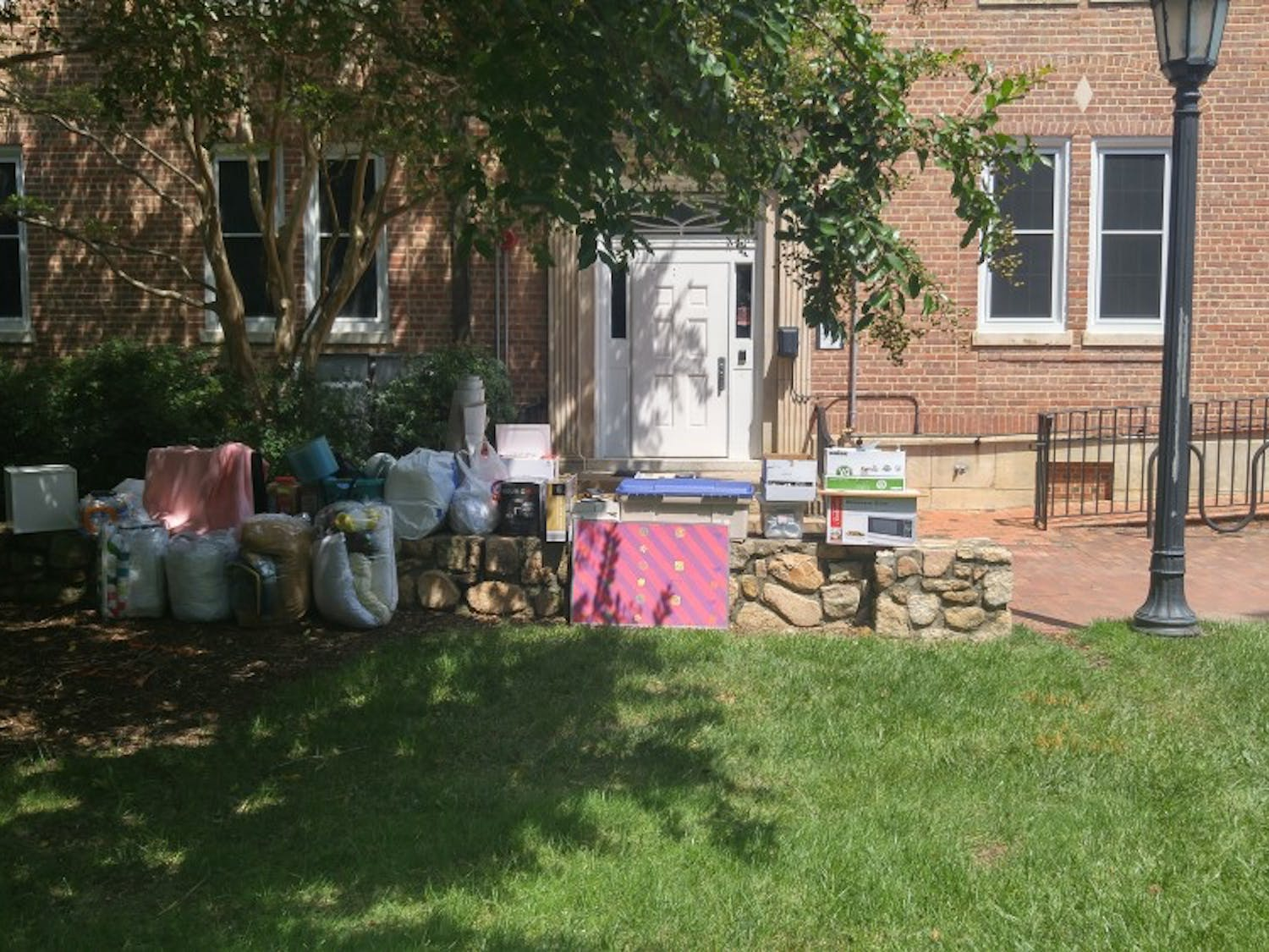 Dorm decor stacks up outside as students move in.