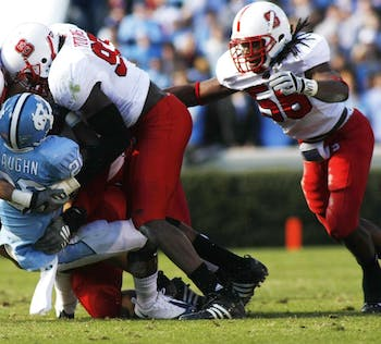 Senior linebacker Nate Irving converges on UNC running back Shaun Draughn in 2008. Irving sat out the 2009 season after suffering major injuries in a one-car accident. He now leads the team in tackles and sacks.