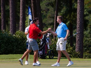 Senior Ryan Gerard shakes hands with his opponent after he won the Rod Myers Invitational at the Duke University Golf Club on Sept. 12, 2021.