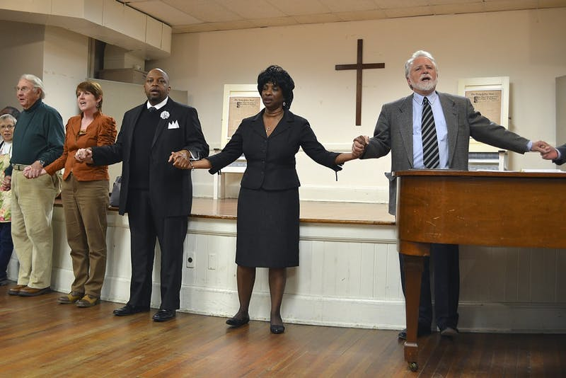 Community members gather in Chapel Hill's University Baptist Church to honor Martin Luther King Jr., who gave a speech in the same room on May 8, 1960.