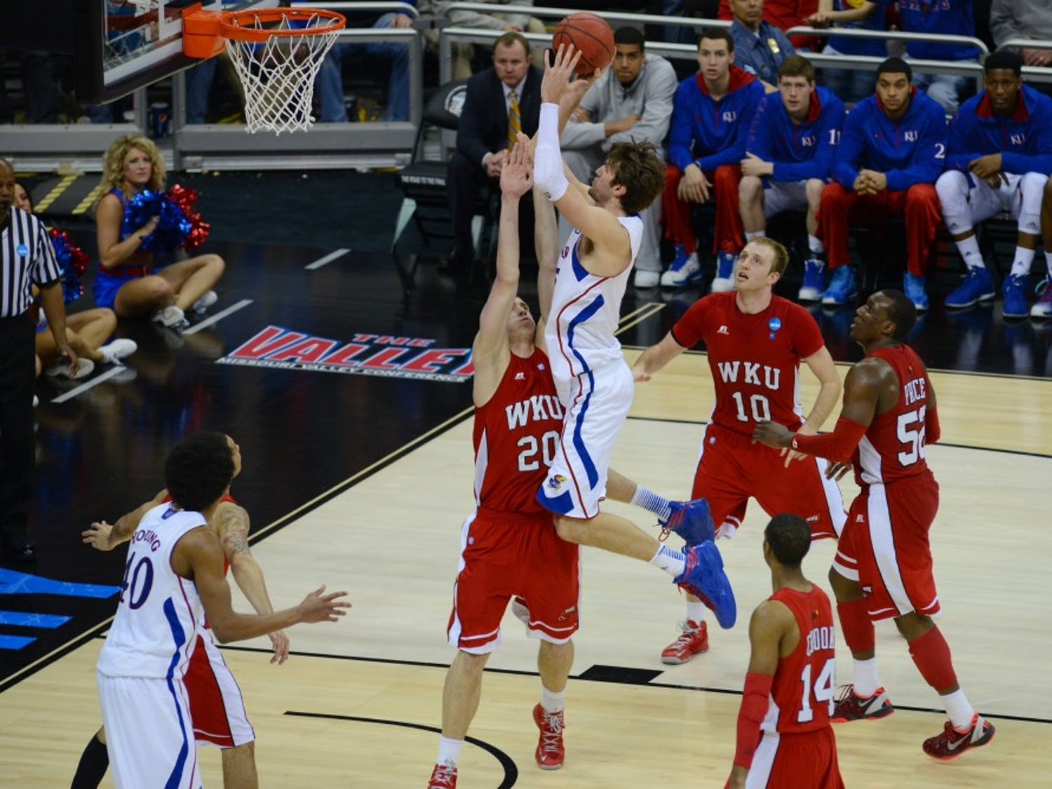 Kansas center Jeff Withey (5) takes a shot over Western Kentucky forward Aleksejs Rostov (20) in the 2nd round of the 2013 NCAA Tournament on March 22nd, 2013 at the Sprint Center in Kansas City, Missouri. Withey had 17 points, 7 blocked shots, and 6 rebounds in the game.