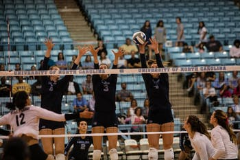 Taylor Borup (4) jumps in the air for a block against Wake Forest on Sunday at Carmichael Arena.