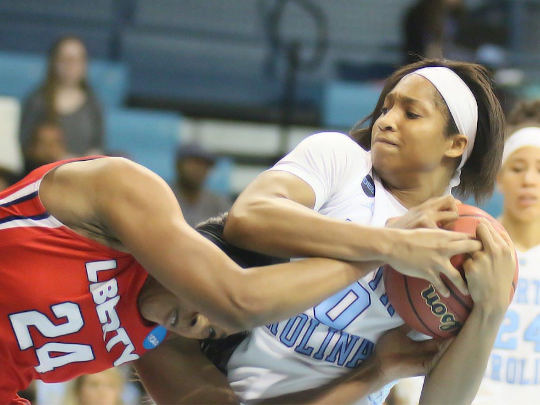 North Carolina senior Danielle Butts (10) battles Jasmine Gardner (24) for a rebound during Saturday's first round game of the Women'sNCAA tournament.