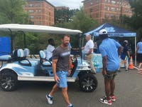Head coach Larry Fedora and the UNC football team assisted in distributing supplies for Hurricane Florence relief efforts on Sept. 18 in the Smith Center parking lot.