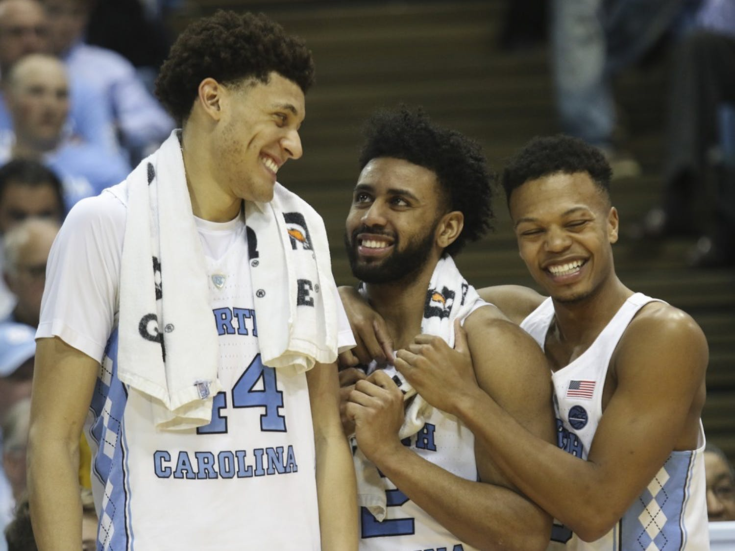 North Carolina teammates Justin Jackson (44), Joel Berry (2) and Nate Britt (0) share a laugh after defeating Duke in the Smith Center on Saturday.