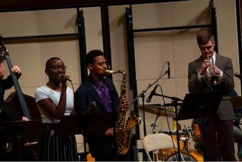 Musician Ricardo Pascal performing alongside student jazz players. Photo courtesy of Jim Ketch.
