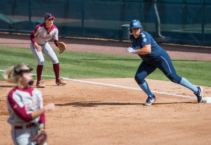 UNC junior pitcher Brittany Pickett (28) pushes off first base to make a run during a double header against the FSU Seminoles at Eugene G. Anderson Softball Stadium on Monday, April 15, 2019. The Tar Heels beat the Seminoles in both games.