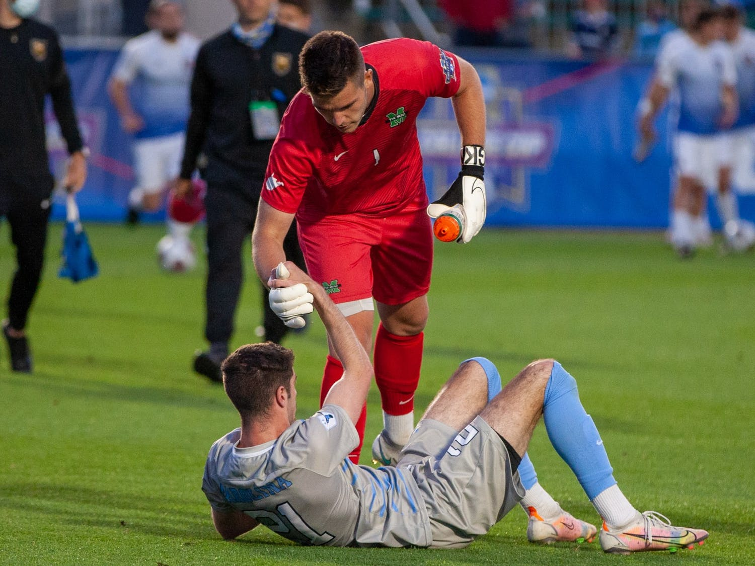 Marshall junior goalkeeper Oliver Semmle (1) gives a hand to UNC senior forawrd Alex Rose (21) after the semifinals of the College Cup against Marshall at the WakeMed Soccer Park in Cary, NC on Friday May 14, 2021. The Tar Heels lost 1-0.